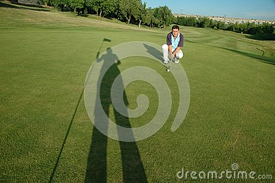 Golfer and shadow