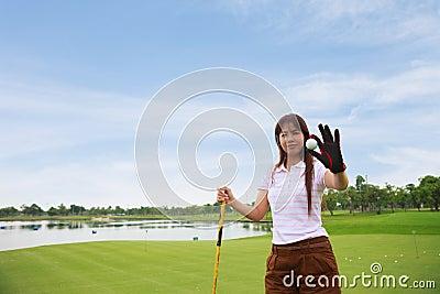 Golfer show golf ball