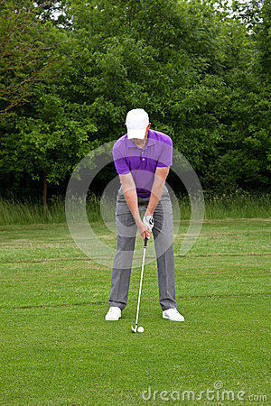 Golfer stance for a mid iron shot