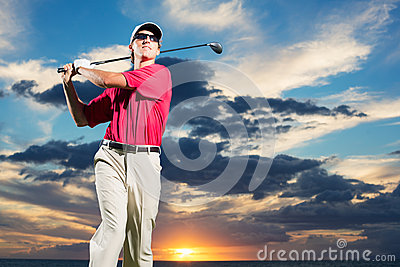 Golfer at sunset