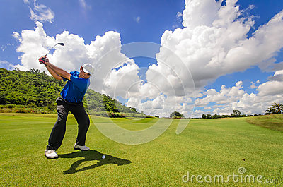 Golfer swinging his gear and hit