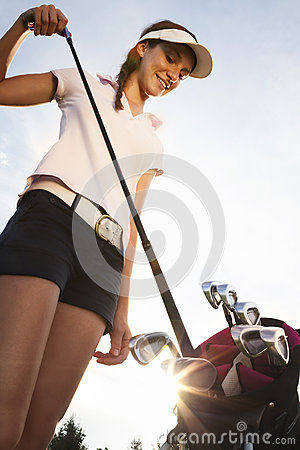 Free Golfer Taking Out Iron From Golf Bag. Royalty Free Stock Photos - 26555608