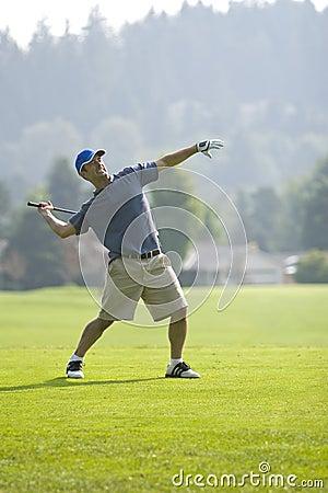 golfer throwing club vertical royalty free stock