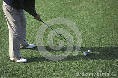 Golfer from waist down preparing