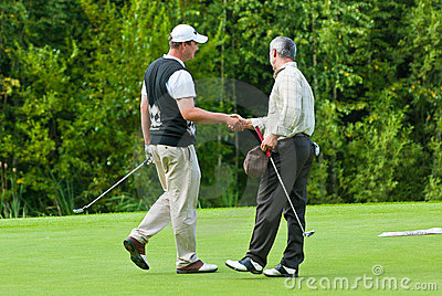 Golfers shake hands Editorial Photography