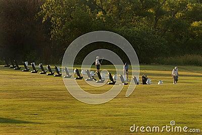 Golfers warming up