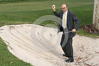 Golfing Businessman Finds Ball