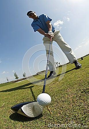 Golfing man