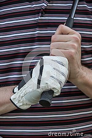 Golfista con el club de la explotación agrícola del guante