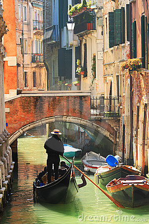 Gondola on canal in Venice, Italy.