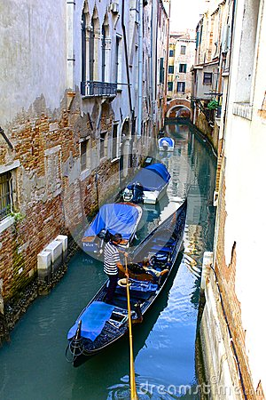 Gondola On a Narrow Venetian Canal Editorial Image