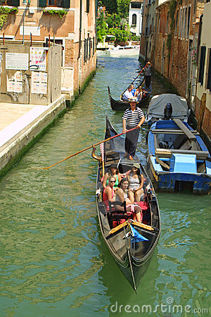 Gondola with passengers in Venice Editorial Image