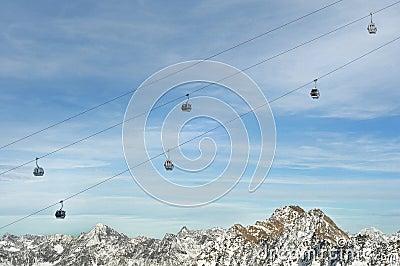 Gondola Ski Lift above Alps Mountains