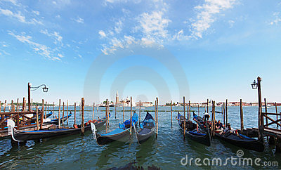 Gondolas anchored on Grand Canal in Venice Editorial Stock Photo