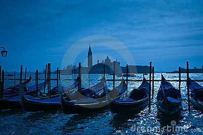Gondolas moored by Saint Mark s square in Venice