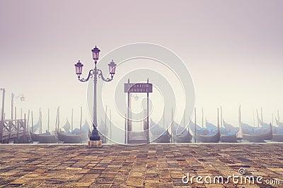 Gondolas in thick fog. Venice - Italy