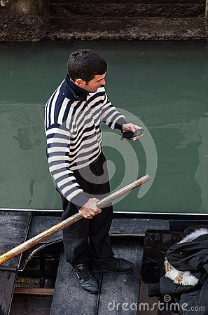 Gondolier Checking his Mobile Phone Editorial Stock Photo