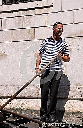 Gondolier in a gondola Editorial Photo