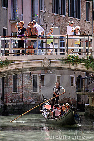 Gondolier, gondola and tourists in Venice Editorial Stock Photo