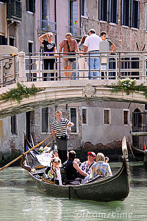 Gondolier, gondola and tourists in Venice Editorial Stock Image
