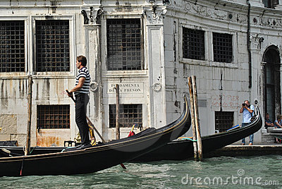 Gondolier on the Grand Canal in Venice, Italy Editorial Photography