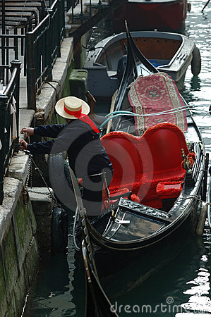 Gondolier preparing boat for tourists,Venice Editorial Photo