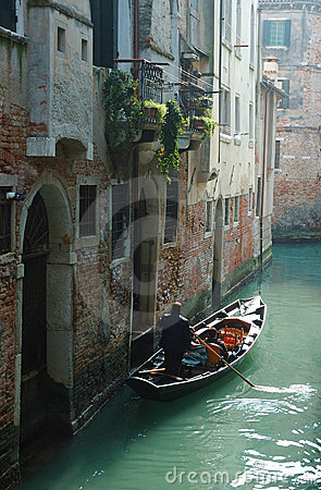 Gondolier taking tourists on Venice canals Editorial Stock Photo