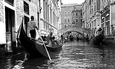 Gondolier and tourists in a gondola Editorial Stock Photo