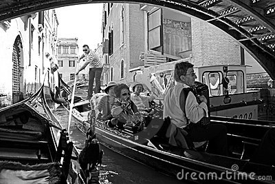 Gondolier and tourists in a gondola Editorial Image