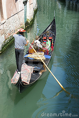 The gondolier - tourists at Venice Editorial Photography