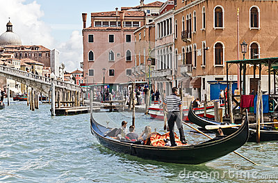 Gondolier on Venice Grand Canal Editorial Photography