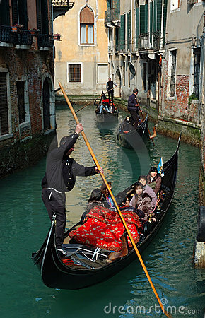 Gondoliers taking tourists on Venice canals Editorial Stock Image