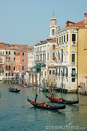 Gondoliers taking tourists on Venice canals,Italy Editorial Image