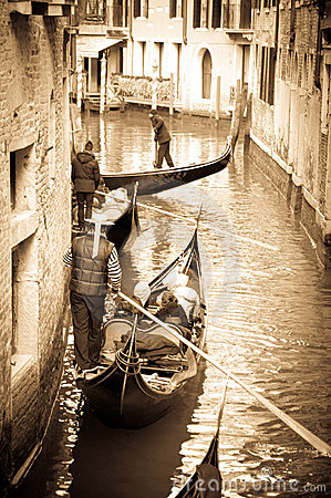 Gondoliers in a venetian canal Editorial Image