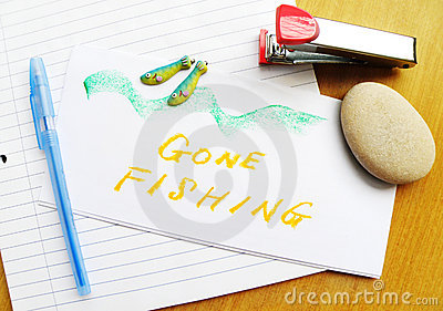 Gone Fishing note on desk
