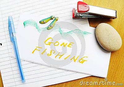Gone Fishing note on desk