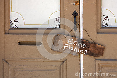 Gone Fishing Sign on old Country Store front door