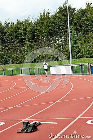 Good-looking male sprinter training