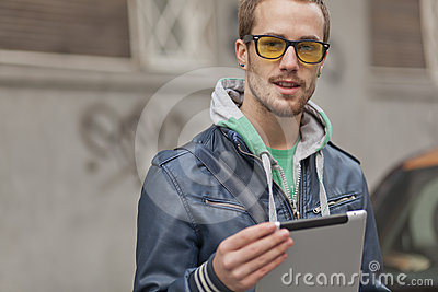 Good looking man on street with Tablet Computer