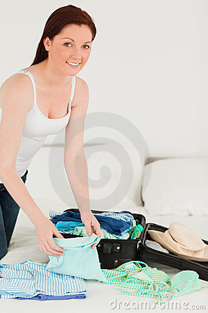 Free Good Looking Woman Packing Her Suitcase Stock Images - 19927344