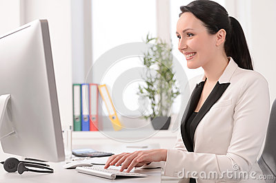 Good working day. Beautiful middle-aged businesswoman sitting at