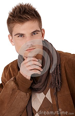 Goodlooking man in coat and scarf