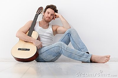 Goodlooking man with guitar smiling