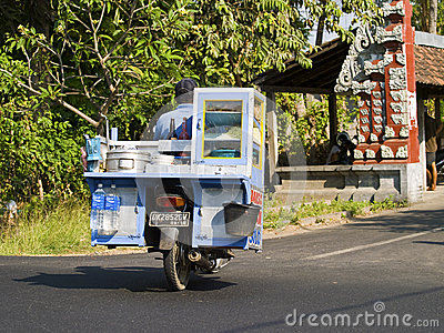 Goods transported on a scooter in Bali, Indonesia Editorial Stock Photo