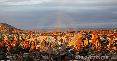 Goreme valley, Turkey, sun, clouds and rainbow Stock Photo