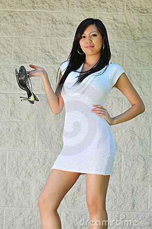 Gorgeous Asian Girl holding her high heels