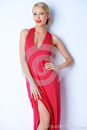 Free Gorgeous Blond Sexy Woman Posing In Pink Dress Stock Photography - 29588142