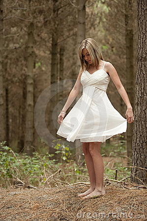 Gorgeous blonde teen girl in forest
