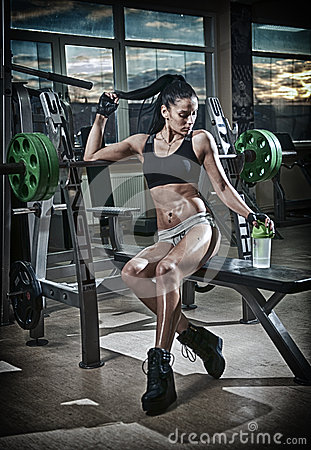 Free Gorgeous Brunette Lifting Some Weights And Working On Her Biceps In A Gym. Fitness Woman Doing Workout. Sporty Girl Doing Exercise Stock Image - 64384611