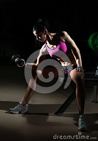 Free Gorgeous Brunette Lifting Some Weights And Working On Her Biceps In A Gym. Fitness Woman Doing Workout. Sporty Girl Doing Exercise Stock Photos - 64475043